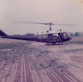 Members of 16 Lincoln Coy being lifted in a Huey for a heli jump, 1970s