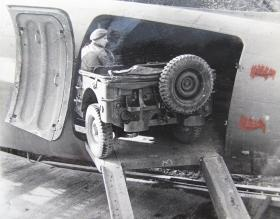 An Airborne jeep being loaded onto an aircraft, c.1944