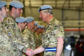 A member of 3 Regt AAC receives his OSM from HRH Prince of Wales, Wattisham, 9 May 2013.