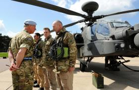 HRH Prince of Wales talks to members of the Army Air Corps. Wattisham, 9 May 2013.