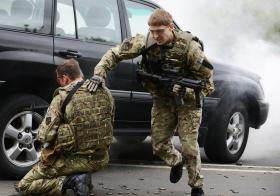 A simulated ambush on the Brigade Commanders car as part of an exercise by 156 Provo COY, Colchester, May 2013.