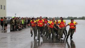 The 7 AA Bn REME team practising for the Field Gun Race, 2013.