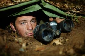Bdr Bliss, 7 PARA RHA, observes the target area from a dug-in observation post during Exercise Sphinx Resolve. September 2013.