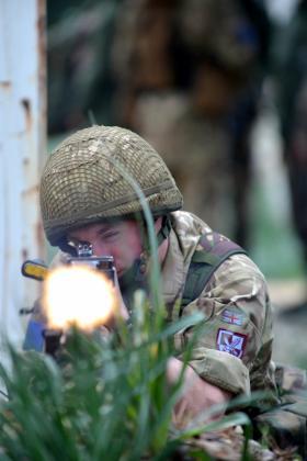 2 PARA soldier firing the General Purpose Machine Gun (GPMG), Exercise BLUE LEGIONNAIRE, January 2014.