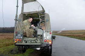 Lieutenant Matthew Williams, 23 Engineer Regiment (Air Assault), taking a break from the weather on Ex Eagles Build, 2014.