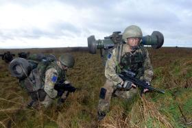 Soldiers carrying Javelin reloads on Ex Blue Panzer, 2 PARA, Salisbury Plain, February 2014.