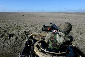 Firing a HMG from the rear of a WMIK, 2 PARA, Ex Blue Panzer, Salisbury Plain, February 2014.