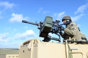 Firing a 40mm GMG from the rear of a WMIK, 2 PARA, Ex Blue Panzer, Salisbury Plain, February 2014.