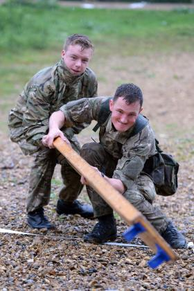 Signallers attempt to overcome an obstacle as part of a competition, Colchester, May 2014.