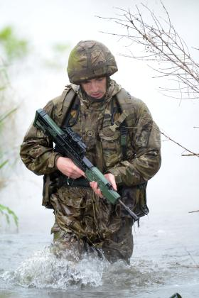 A signaller taking part in the military skills competition, Colchester, May 2014.