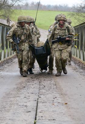 Troops evacuating casualties in festive challenges, 10 December 2014.