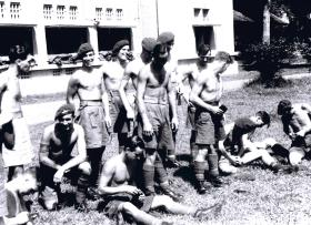 2 Platoon, A Company, 12th Para Bn filling Bren magazines in a fortified building in Semarang, Java c1945.