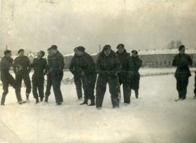 Members of A Squadron, 6th Armoured Recce Regiment relax in the snow, Belgium, 1945