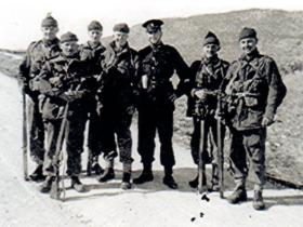 Members of a section from A Coy, 1 PARA, with a Turkish Cypriot Policeman, at the base of Kyrenia Mountains, Cyprus, 1956.