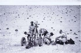 2nd Airlanding Anti-Tank crew firing a 4.2 inch mortar at the Living Firing Camp, Asluj, Palestine