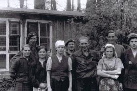 Ptes Piercey, Salter and Murray with liberated Polish slave workers, April 1945.