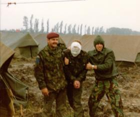 Practising First Aid !, members of Anti Tank Platoon, 2 PARA, on exercise in Denmark, 1981.