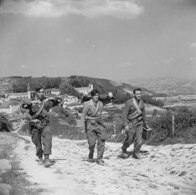 Members of 2 SAS climb a mountain path in Italy, 1945.