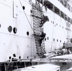 Boarding a Landing Ship Tank from SS Chitral for landing at Morib, Malaya, September 1945.