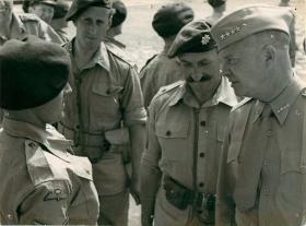 General Eisenhower talks to an officer.