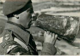 An officer from 1st Airlanding Light Artillery Regiment shouts through a loud haler.