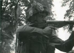 Private Morris on guard with a Sten gun at Divisional HQ, Oosterbeek.
