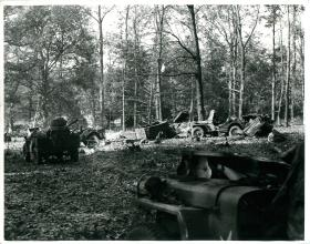 Wrecked jeeps and trailers in the Hartenstein Hotel grounds (Divisional HQ).
