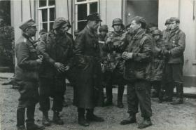 Polish paratroopers being interrogated by Germans.