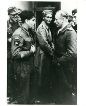 Captured British paratrooper Dave Morris (11 Parachute Battalion) is taken PoW at Oosterbeek.