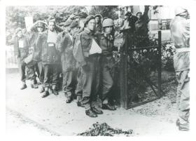 Captured British paratroopers marched out of the Vreewijk Hotel after bitter fighting in Oosterbeek.