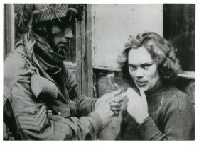 A British Glider pilot lights the cigarette of a female German telegraphist taken PoW at Arnhem