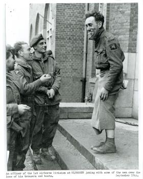 An officer of 1st Airborne Division jokes about his lack of trousers after crossing the river Rhine.