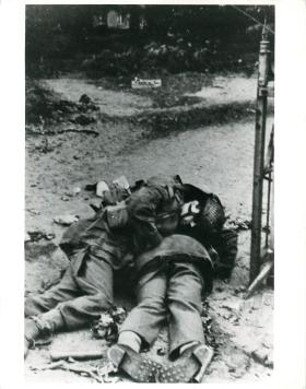 Photo of two dead Allied soldiers posed by Germans in Oosterbeek.