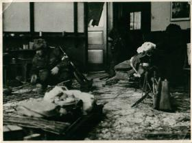 Polish paratroopers in a heavily shell ravaged building  in Driel where they dropped.
