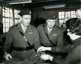 Major General Frank King MBE and Lieutenant Colonel Adams MBE inspecting an extractor parachute.