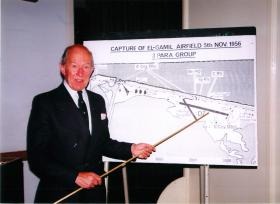 Major Mike Walsh with a map of El Gamil airfield at a Suez lecture in 1996.