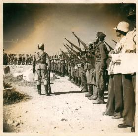 Troops from the Greek People's Liberation Army line up for inspection.