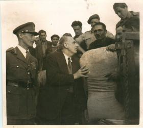Greek PM Georgios Papandreou and General Scobie with food supplies.