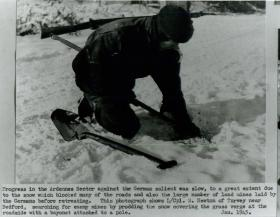 Lance Corporal Newton searching for enemy mines in the snow.