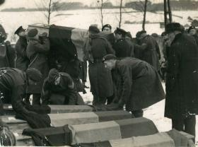 British Paras lift coffins of civilians executed in the Bande atrocity.