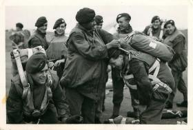 Paratroopers have their kit checked before emplaning.