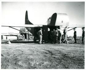 Paratroopers prepare for operations in Greece and load a Waco glider.