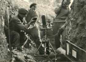 Three paratroopers from 5th Parachute Battalion load a mortar.