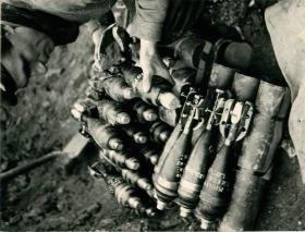A private preparing mortar shells.