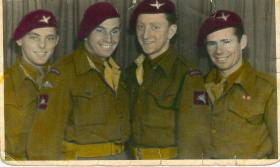 Four British paratroopers smile for the camera in Norway, 1945.