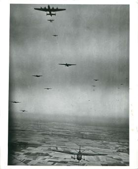 Halifaxes tow Horsa gliders over the French coast.