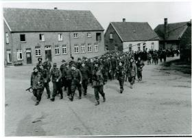 Glider pilots with German prisoners near Hamminkeln railway station, March 1945.