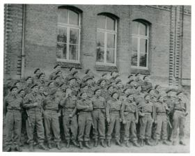 Group photo of J section Signals, 3rd Parachute Brigade in Wismar May 1945.