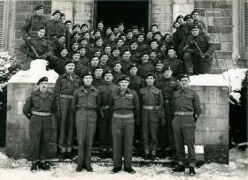 Group photo of Montgomery, Maj-Gen Bols and members of the division. January1945.
