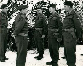 Montgomery talks to Maj-Gen Bols, Brig Flavell, Brig Hill and Brig Poett. January 1945.